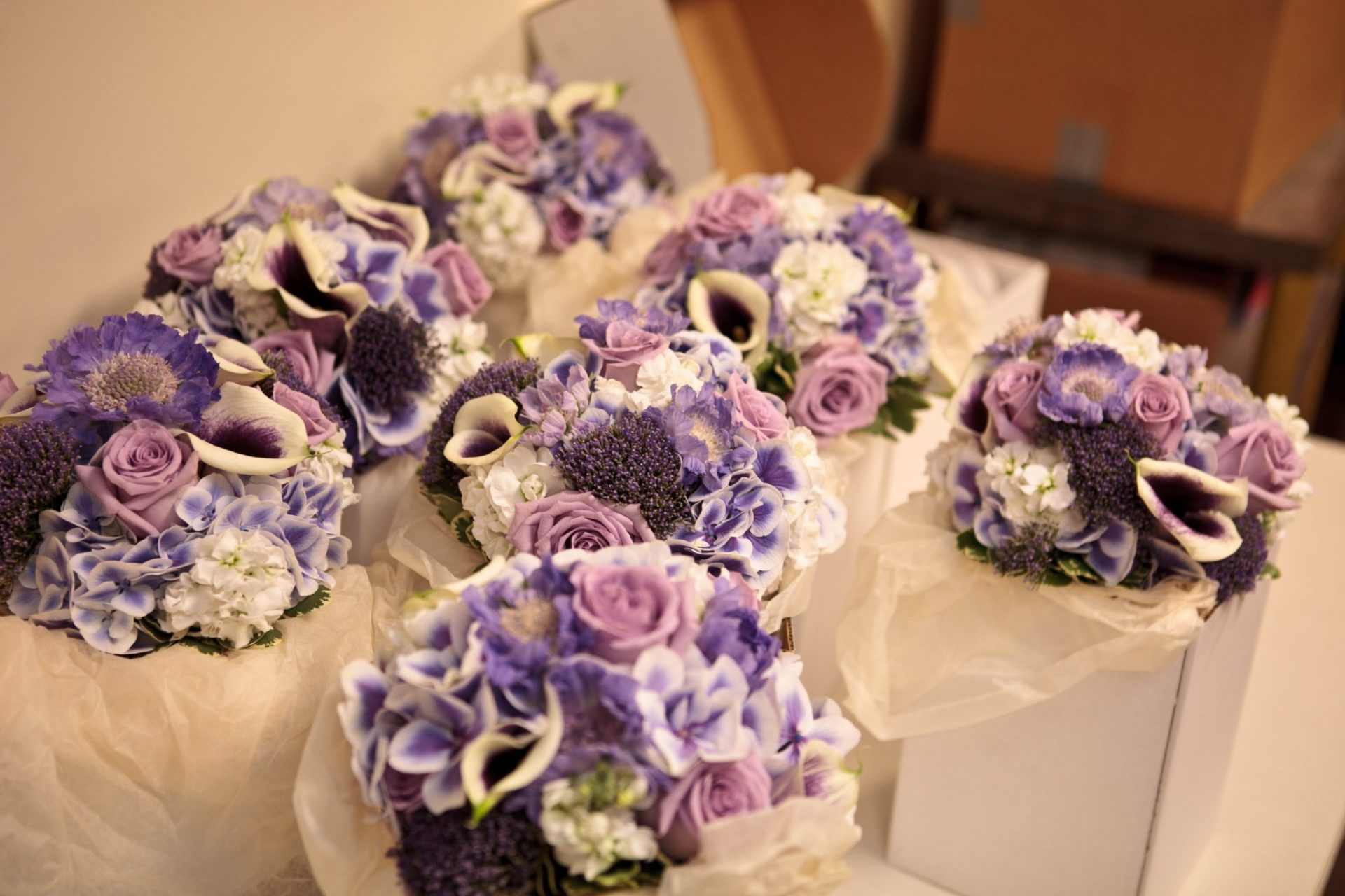 Lavender bouquets of hydrangea, roses, calla lilies and scabiosa.