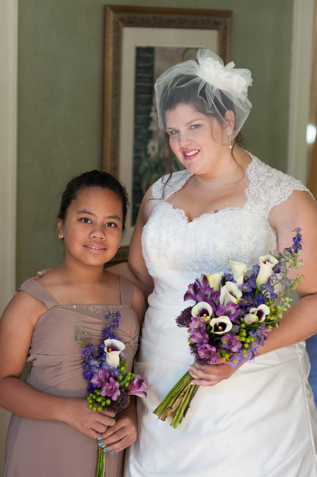 Garden style arm bouquet of lavender florals.