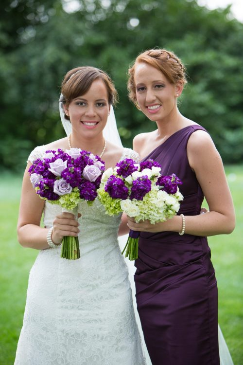 Lavender, green, and white bride and bridesmaid bouquets.