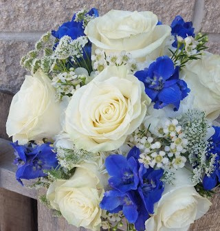 Lovely bouquet of white roses and blue delphinium.