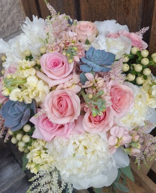 Gorgeous bouquet of peonies, roses, stock, hypericum, astilbe, and succulents.