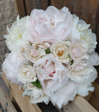 Just a hint of blush pink in this spring bridal bouquet of peonies and roses.